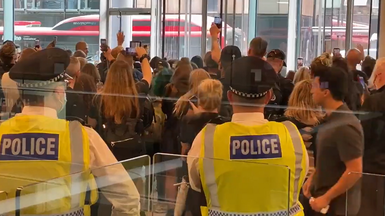 Footage from inside the ITN reception area shows a large crowd of protesters with police. Credit: Carl Nasman