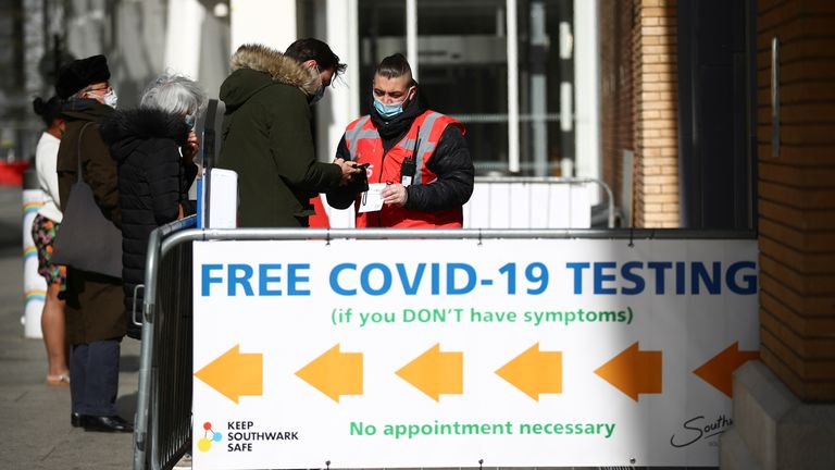 People queue outside a coronavirus disease (COVID-19) test centre at London Bridge Station