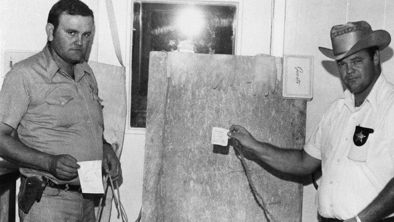 Sheriff deputies display torture tools linked to Dean Corll. Pic: AP
