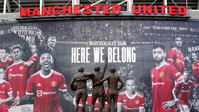A statue to Denis law stands between those of George Best and Sir Bobby Charlton outside the Manchester United stadium