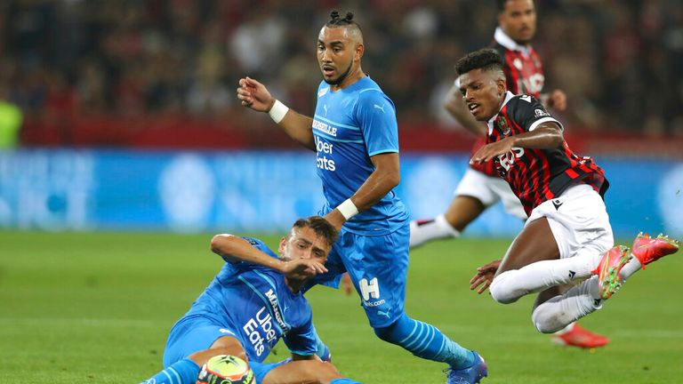 Dimitri Payet (C) was struck with a bottle by Nice fans