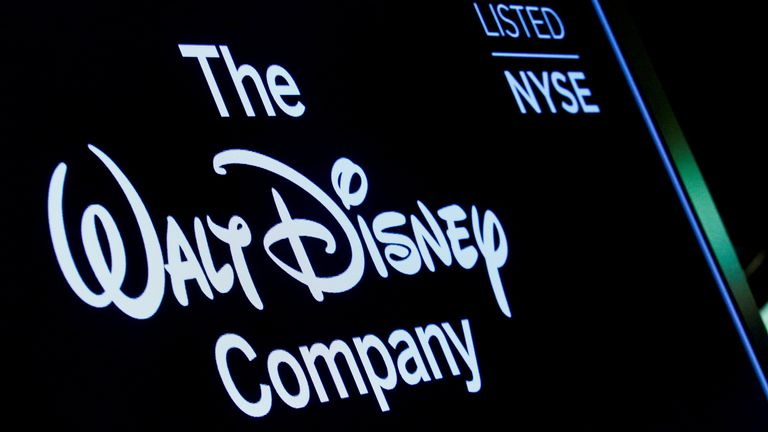 A screen shows the logo and a ticker symbol for The Walt Disney Company on the floor of the New York Stock Exchange (NYSE) in New York, U.S., December 14, 2017