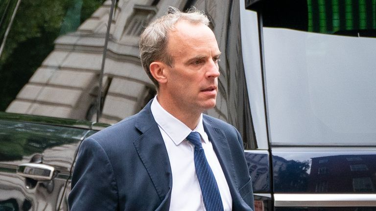 Foreign Secratary Dominic Raab walks to the rear entrance of Downing Street in Westminster, London