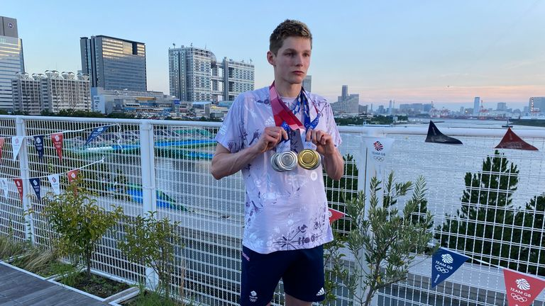 Duncan Scott walked away with four medals clinking together - three silvers and one gold
