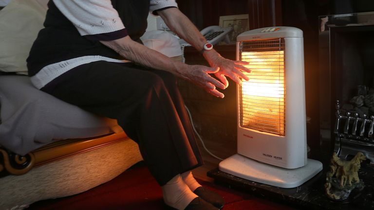A generic stock photo of an elderly lady with her electric fire on at home in Liverpool. PRESS ASSOCIATION Photo. Picture date: Wednesday November 19, 2014. Photo credit should read: Peter Byrne/PA Wire
