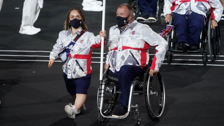 Great Britain flag bearers Ellie Simmonds and John Stubbs
