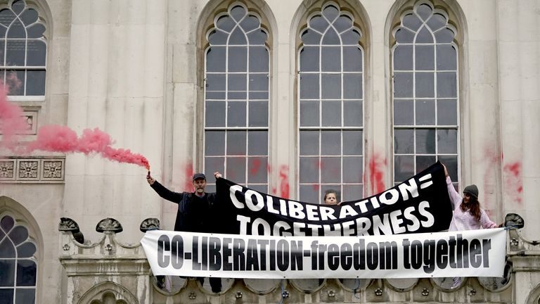 Around 200 people attended a protest at the Guildhall building in London on Sunday - with police making nine arrests