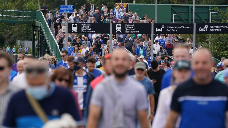 Fans arriving at the ground ahead of the Premier League match at Amex Stadium, Brighton. Picture date: Saturday August 28, 2021.
