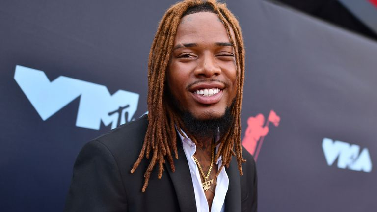 FILE - In this Aug. 26, 2019 file photo Fetty Wap arrives at the MTV Video Music Awards at the Prudential Center on in Newark, N.J. Police in Las Vegas say rapper Fetty Wap was arrested after allegedly assaulting three employees at a hotel. Police say the 28-year-old whose real name is Willie Maxwell was arrested Sunday morning, Sept. 1 on three counts of battery. (Photo by Charles Sykes/Invision/AP,File)