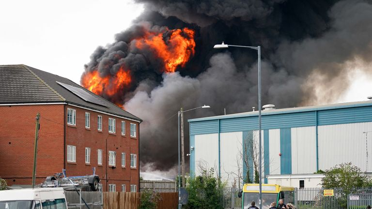 A large fire at an industrial estate has prompted the evacuation of surrounding properties as it is feared the blaze may involve chemicals.