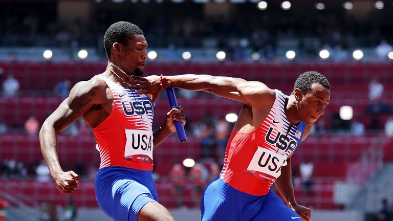 Fred Kerley (L) hands the baton to Ronnie Baker. Pic: Diego Azubel/EPA-EFE/Shutterstock
