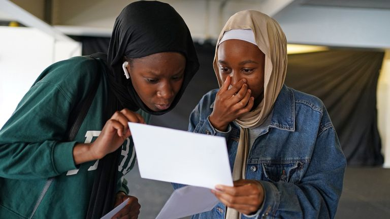 Hajara Yousouf (right) and a friend open their GCSE results at CORE's City Academy in Birmingham. Picture date: Thursday August 12, 2021.