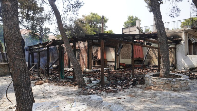 The burned-out homes of residents