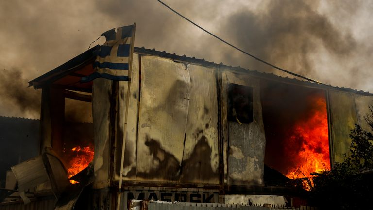 Homes and businesses have been destroyed in Greece, with thousands evacuated