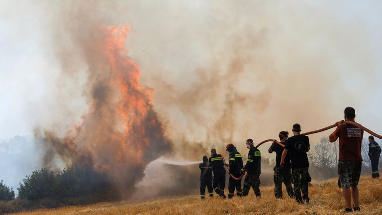 Firefighters battled 154 wildfires on Friday, with 64 burning into the night