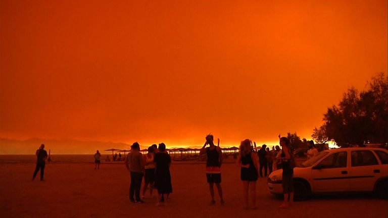 Fires burn ominously on the horizon