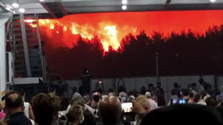 Over a thousand people were evacuated from the Greek island of Evia on August 6 as flames towered over the water.