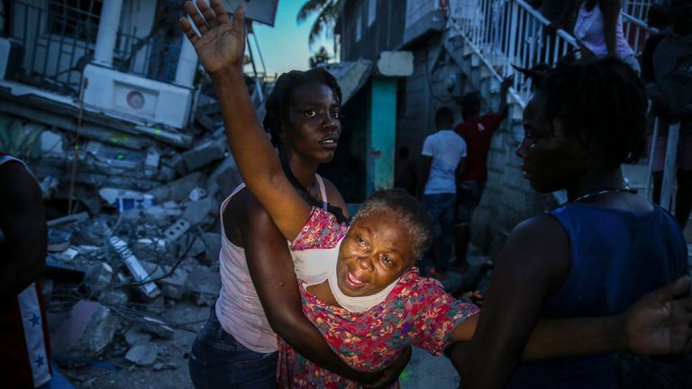 Oxiliene Morency cries out in grief after her 7-year-old daughter's body was recovered from the rubble of their home. Pic AP