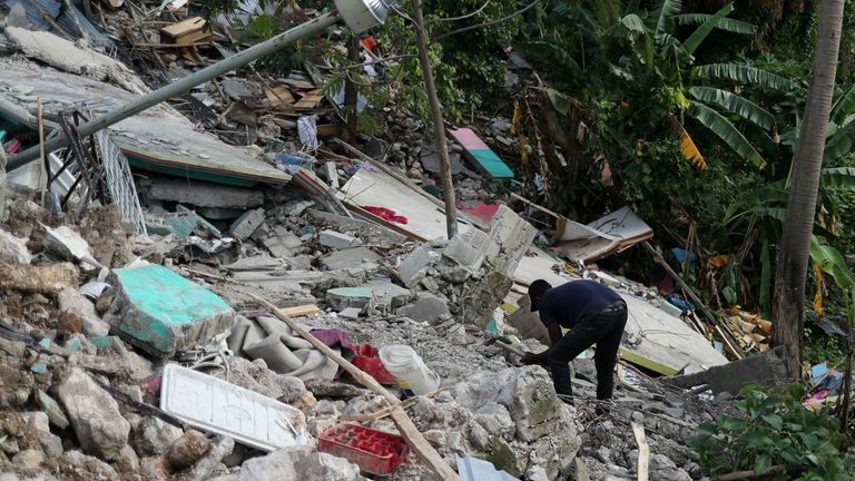 Residents continue to search through the rubble for missing people