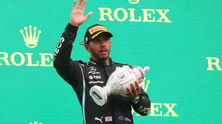 Formula One F1 - Hungarian Grand Prix - Hungaroring, Budapest, Hungary - August 1, 2021 Third placed Lewis Hamilton of Mercedes celebrates on the podium after the race REUTERS/Florion Goga