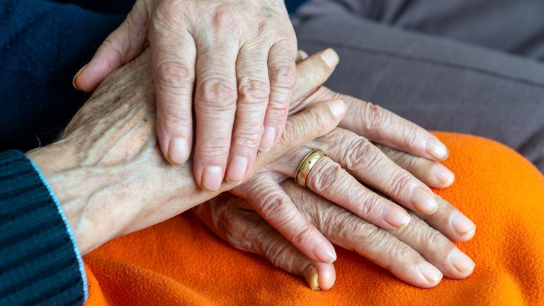 Close up photo of senior heterosexual couple hands with wedding ring. Hands are wrinkled. They are 80 plus years old. Shot indoor with a full frame mirrorless camera. pic Istock