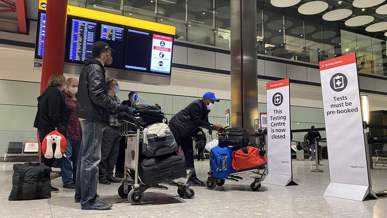 Passengers waiting outside the testing centre in Heathrow Airport