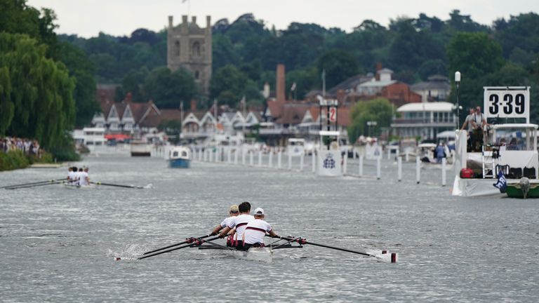 A rowing crew make their way up towards the start on the opening day of the 2021 Henley Royal Regatta