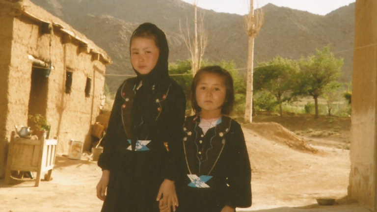 Ms Razai, left, is seen here going to school with her sister in Afghanistan