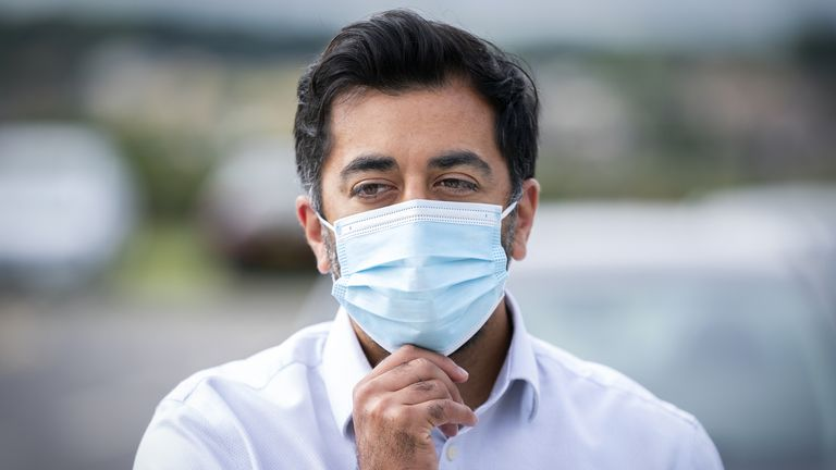Health Secretary Humza Yousaf adjusts his protective face mask before visiting the NHS Golden Jubilee National Hospital, in Clydebank, Glasgow