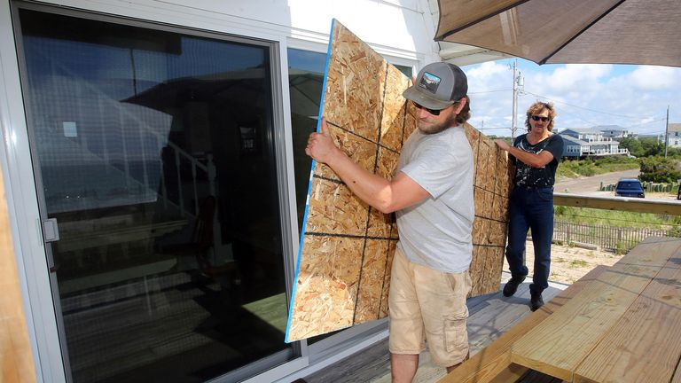 People in Rhode Island boarded up windows as they brace for Hurricane Henri to hit. Pic AP