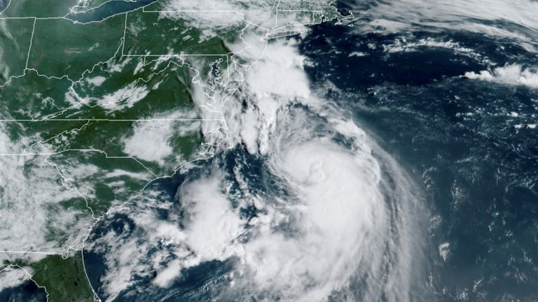Satellite images show the storm edging closer to New England, as residents prepare for the worst storm in decades