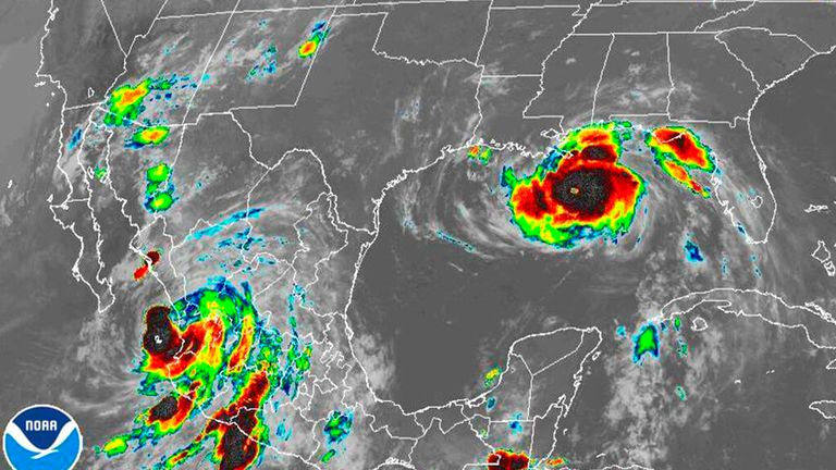 Ida (right) is due to hit as Nora (lower left) travels northward up Mexico's Pacific Coast (Pic NOAA via AP)