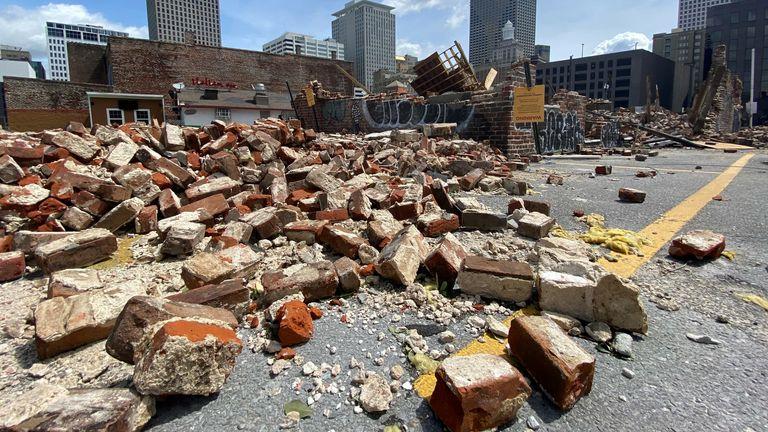 Hurricane Ida was downgraded to tropical storm  on Tuesday after Joe Biden declared 'major disaster' in Louisiana