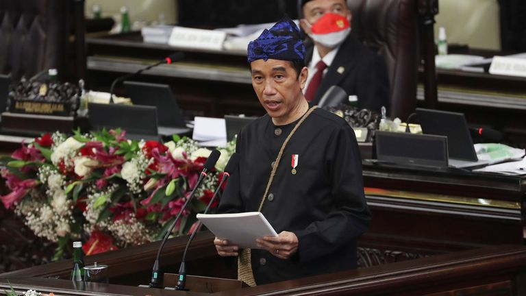 Indonesian President Joko Widodo, wearing traditional Baduy outfit, delivers his annual State of the Nation Address ahead of the country's Independence Day, at the parliament building in Jakarta, Indonesia, August 16, 2021. Achmad Ibrahim/Pool via REUTERS