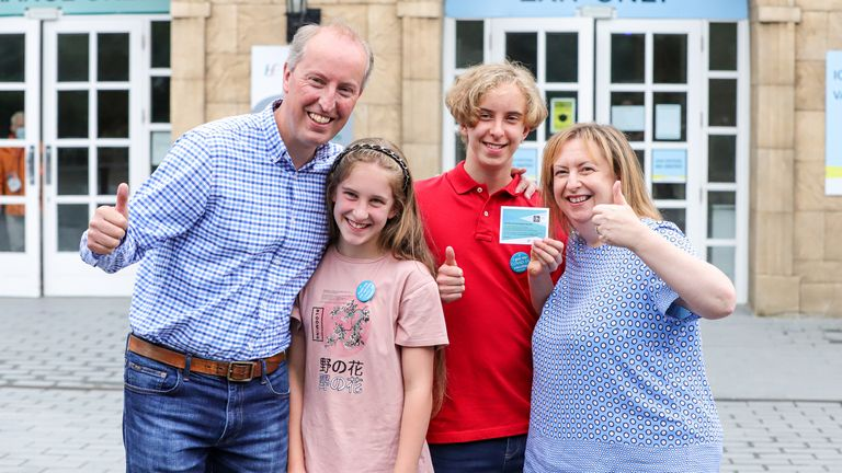 Michael and Rebecca Shelley with their children Bill, aged 14, and Sarah, aged 12, after they received their first dose of the Covid-19 vaccine at the Citywest vaccination centre in Dublin. Vaccinations of children and teenagers is underway across Ireland, with more than 23 percent of those aged 12 to 15 registered to receive the jab. Picture date: Saturday August 14, 2021.