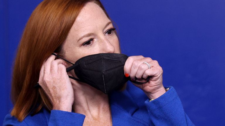 Press Secretary Jen Psaki adjusts her mask during the daily press briefing