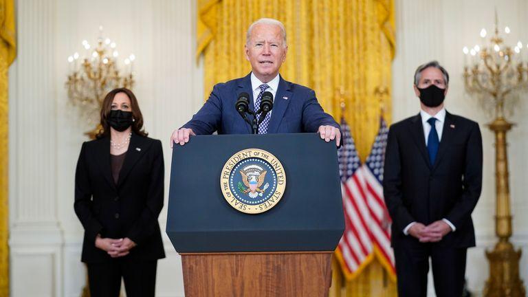 President Joe Biden flanked by Vice President Kamala Harris and US Secretary of State Anthony Blinken