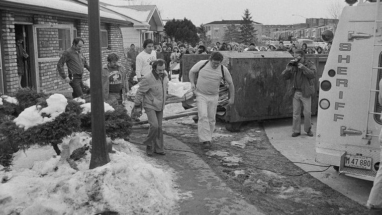 Police search the home of John Wayne Gacy. Pic: AP