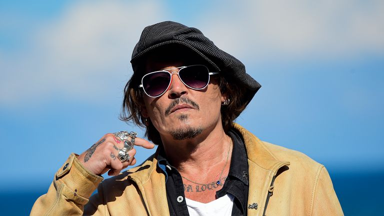 """US actor and film producer Johnny Deep during the photocall for his film """"Crock of Gold: A Few Rounds with Shane Macgoman"""" at the 68th San Sebastian Film Festival, in San Sebastian, northern Spain. Britain's judicial office said Tuesday Oct. 27, 2020, that judge Andrew Nicol will deliver his verdict in writing on Nov. 2, ruling on whether Johnny Depp was libelled by a tabloid newspaper that branded him a wife-beater. (AP Photo/Alvaro Barrientos"""