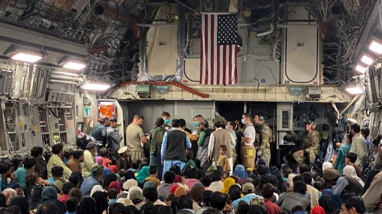 FILE PHOTO: A newborn baby is looked after prior taking off with other Afghan evacuees on a C-17 Globemaster III at a Middle East staging area August 23, 2021. Picture taken August 23, 2021. U.S. Air Force//Handout via REUTERS THIS IMAGE HAS BEEN SUPPLIED BY A THIRD PARTY./File Photo