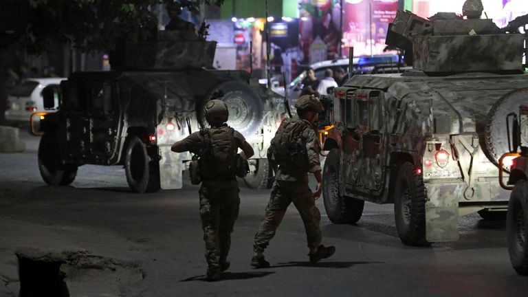 Afghan security personnel arrives at the site of a powerful explosion in Kabul, Afghanistan, Tuesday, Aug. 3, 2021. The explosion rocked a posh neighborhood of the Afghan capital where several senior government officials live. (AP Photo/Rahmat Gul)