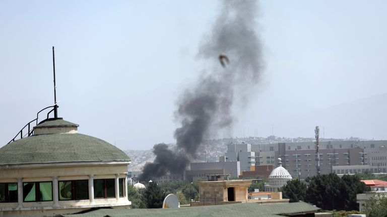 Smoke rises next to the U.S. Embassy in Kabul, Afghanistan, Sunday, Aug. 15, 2021. Helicopters are landing at the U.S. Embassy in Kabul as diplomatic vehicles leave the compound amid the Taliban advanced on the Afghan capital. (AP Photo/Rahmat Gul).