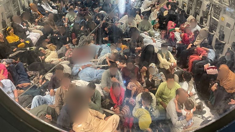 Passengers on board a Royal Air Force C-17 evacuation flight out of Kabul airport