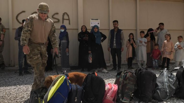 Security checks o the bags of those Afghans being evacuated from Kabul
