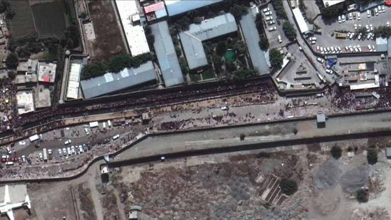 Crowds gather outside the airport in Kabul. Pic:: Maxar Technologies