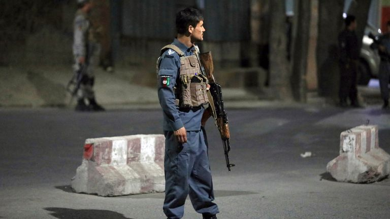 Afghan security personnel stand guard at the site of a powerful explosion in Kabul, Afghanistan, Tuesday, Aug. 3, 2021. The explosion rocked a posh neighborhood of the Afghan capital where several senior government officials live. (AP Photo/Rahmat Gul)