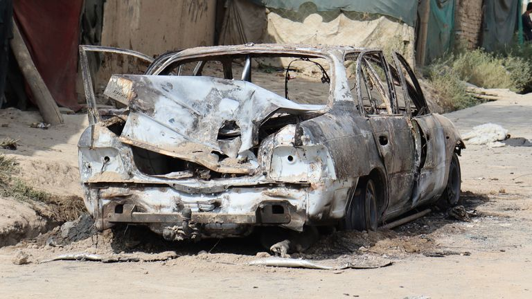 A destroyed vehicle is seen where rockets were fired from in Kabul. Pic: AP