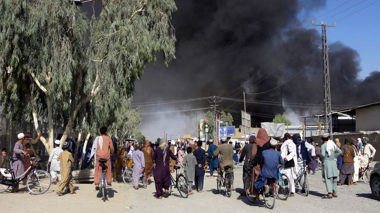 Smoke rises after fighting between the Taliban and Afghan security personnel in Kandahar, southwest of Kabul, on Thursday. Pic: AP