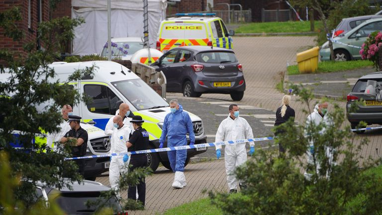 Forensic officers in Biddick Drive in the Keyham area of Plymouth where six people died of gunshot wounds