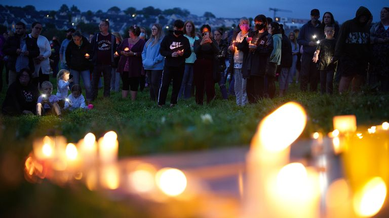 Mourners gathered in a park close to where the mass shooting took place